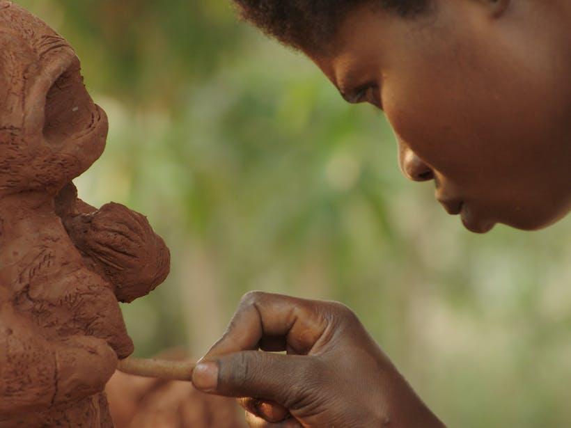 Irene Kanga Working On Sculpture
